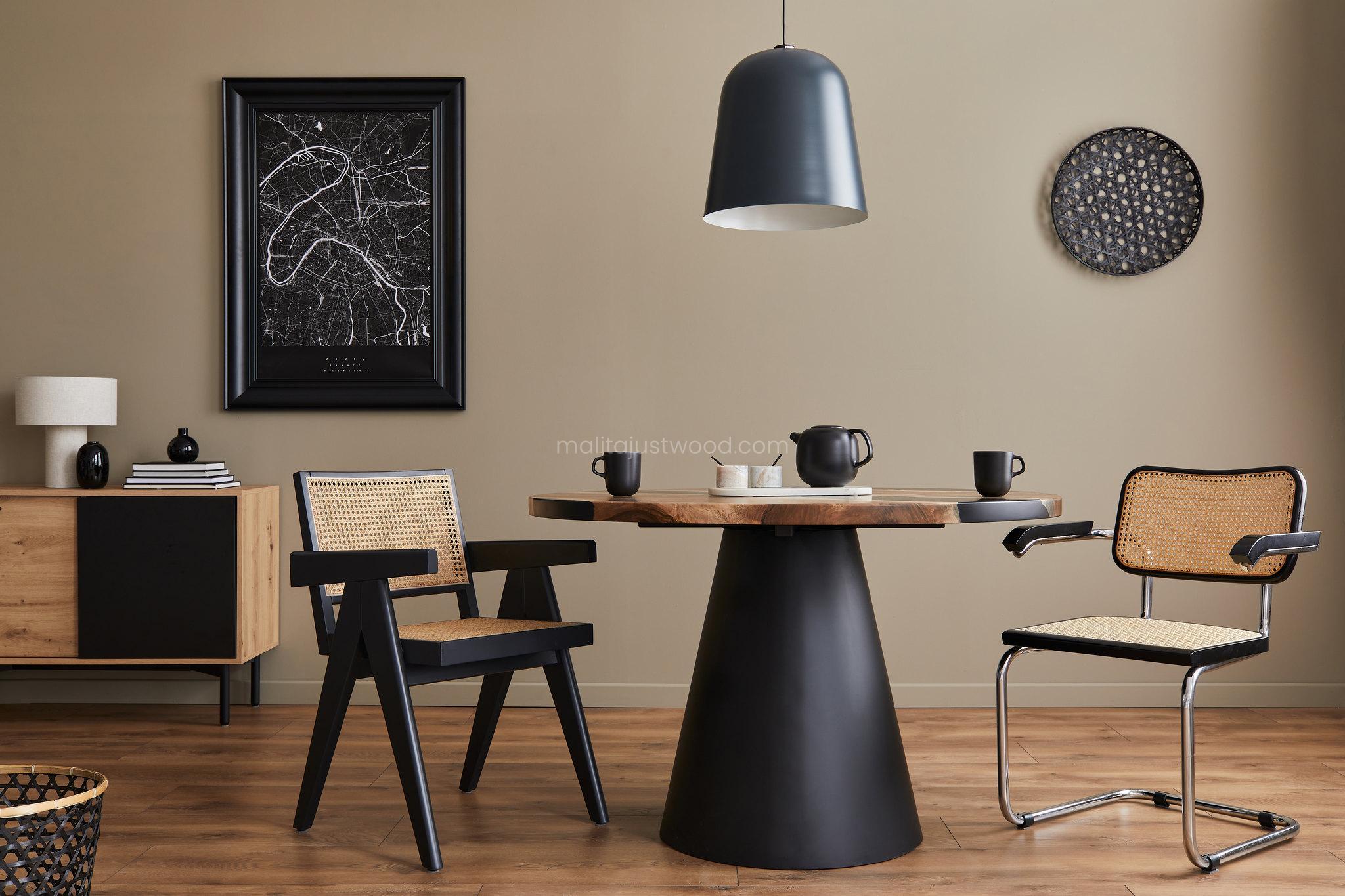 Awangardowe i minimalistyczne wnętrze ze stołem z metalową nogą i czarną żywicą