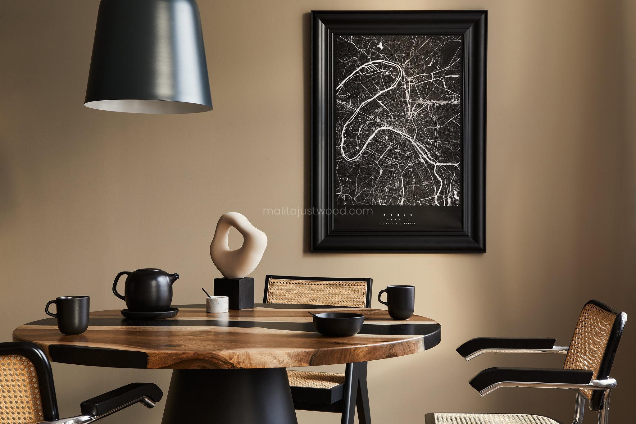 Lekka, designerska i nowoczesna aranżacja - okrągły stół z żywicy i metalową nogą